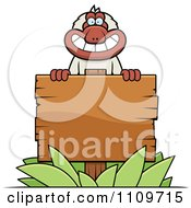 Clipart Macaque Monkey With A Wooden Sign Royalty Free Vector Illustration by Cory Thoman