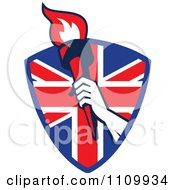 Retro Athlete Holding Up A Flaming Torch Over A British Union Jack Flag Shield