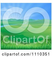 Sun Shining Over A Spring Time Landscape With Rolling Hills And A River