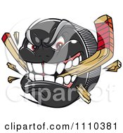Clipart Aggressive Hockey Puck Biting And Snapping A Stick 2 Royalty Free Vector Illustration