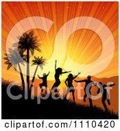 Silhouetted People Dancing And Jumping By Palm Trees Under A Tropical Sunset Burst