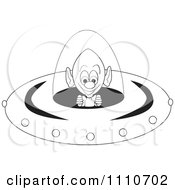 Clipart Black And White Alien Operating The Controls Of A Flying Saucer Royalty Free Vector Illustration