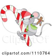 Clipart Cute Christmas Mouse Holding A Gingerbread Man On A Giant Candy Cane Royalty Free Vector Illustration