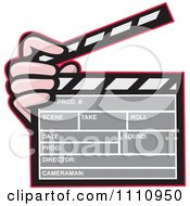 Clipart Hand Holding A Movie Clapper Board Royalty Free Vector Illustration by patrimonio