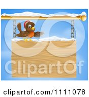 Clipart Christmas Robin Presenting On A Wooden Shingle Sign With Snow Royalty Free Vector Illustration by AtStockIllustration