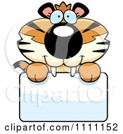 Clipart Cute Happy Tiger Cub Over A Sign Royalty Free Vector Illustration