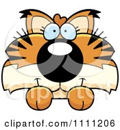 Clipart Cute Bobcat Cub Hanging Over A Sign Royalty Free Vector Illustration