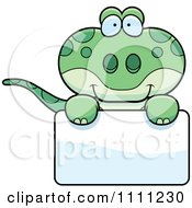 Clipart Cute Gecko Lizard Over A Sign Royalty Free Vector Illustration