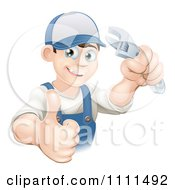 Clipart Happy Mechanic Plumber Or Handy Man Holding A Thumb Up And A Wrench Royalty Free Vector Illustration