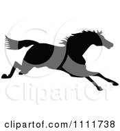 Clipart Silhouetted Running Horse In Black And White Royalty Free Vector Illustration
