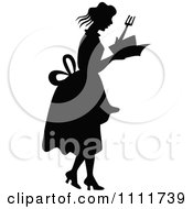 Clipart Silhouetted Woman Holding A Cook Book In Black And White Royalty Free Vector Illustration