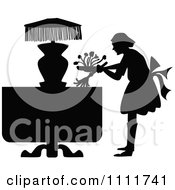 Silhouetted Maid Dusting A Table In Black And White