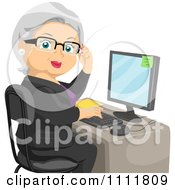 Clipart Female Senior Citizen Working At An Office Computer Desk Royalty Free Vector Illustration