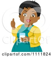 Happy Black Female Senior Citizen Holding A Thumb Up And Glass Of Milk