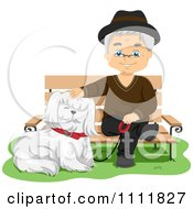 Happy Male Senior Citizen With A Dog At A Park Bench