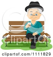 Happy Male Senior Citizen With Coffe On A Park Bench
