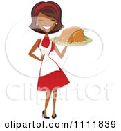 Clipart Happy Black Retro Woman Carrying A Roasted Thanksgiving Or Christmas Turkey On A Platter Royalty Free Vector Illustration by Amanda Kate #COLLC1111839-0177