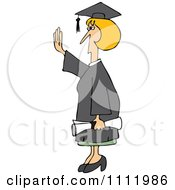 Female College Graduate Holding Her Hand Up