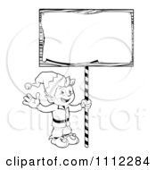 Clipart Outlined Waving Christmas Elf With A Sign Royalty Free Vector Illustration