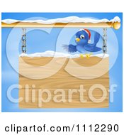 Clipart Christmas Bluebird Perched In Snow And Presenting A Hanging Wood Sign Against A Sky Royalty Free Vector Illustration by AtStockIllustration