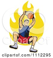 Basketball Player Dunking The Ball Over Flames