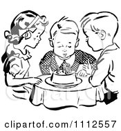Clipart Retro Black And White Children Watching A Boy Blow Out His Birthday Cake Candles Royalty Free Vector Illustration