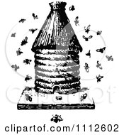 Clipart Retro Black And White Apiology Bee Hive With A Swarm Royalty Free Vector Illustration
