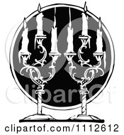 Clipart Black And White Vintage Pair Of Candle Sticks Over A Black Circle Royalty Free Vector Illustration