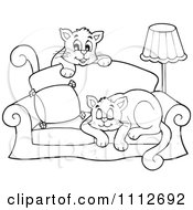 Clipart Outlined Cats Playing And Sleeping On A Sofa Royalty Free Vector Illustration