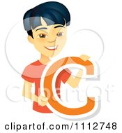 Happy Asian School Boy Holding A Letter C