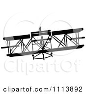 Clipart Vintage Black And White Biplane Royalty Free Vector Illustration