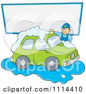Man Washing A Green Car Under A Sign