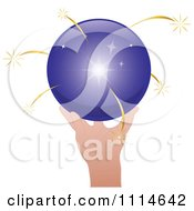 Hand Holding A Shiny Purple Sphere With Gold Sparks