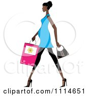 Slender African American Pregnant Woman Walking With A Shopping Bag And Purse