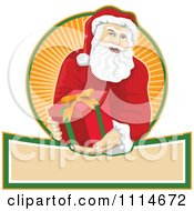 Clipart Santa Holding Out A Present Over A Banner And Circle Of Orange Rays Royalty Free Vector Illustration