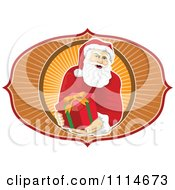 Clipart Santa Holding Out A Present Over Orange Rays Royalty Free Vector Illustration