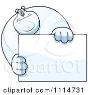Clipart Buff Polar Bear Holding A Sign 1 Royalty Free Vector Illustration