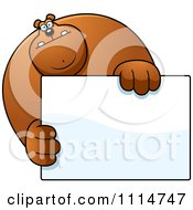 Clipart Buff Bear Holding A Sign 1 Royalty Free Vector Illustration