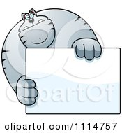 Clipart Buff Gray Cat Holding A Sign 1 Royalty Free Vector Illustration