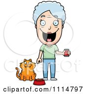 Happy Senior Woman Feeding Her Cat