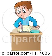 Stressed School Boy Writing At His Desk