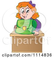 Red Haired School Girl Smiling Over A Green Bag On Her Desk