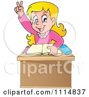 Blond School Girl Raising Her Hand At Her Desk Over A Book