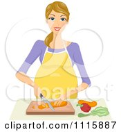 Happy Blond Pregnant Woman Chopping Veggies