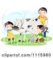 Happy Kids Milking A Cow