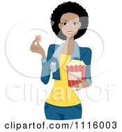 Beautiful Black Woman Holding A Movie Ticket And Popcorn