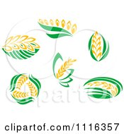 Clipart Strands Of Wheat And Green Leaves Royalty Free Vector Illustration