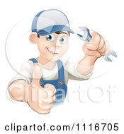 Vector Clipart Of A Happy Mechanic Plumber Or Handy Man WorkerHolding A Thumb Up And A Wrench Royalty Free Graphic Illustration