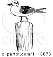 Clipart Of A Retro Vintage Black And White Seagull On A Post Royalty Free Vector Illustration