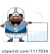 Vector Cartoon Of A Chubby Black Football Player With A Sign Royalty Free Clipart Graphic